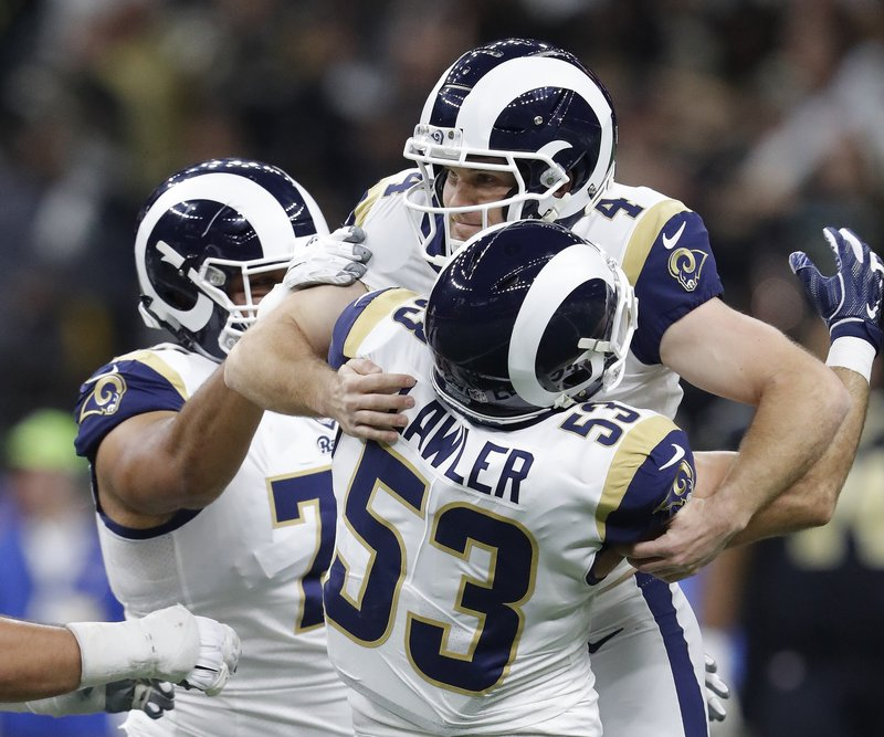 Los Angeles Rams' Greg Zuerlein is congratulated after making the game-winning field goal during overtime of the NFL football NFC championship game against the New Orleans Saints Sunday, Jan. (AP Photo/John Bazemore)