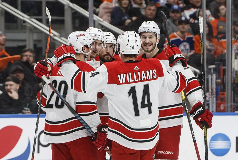 Carolina Hurricanes players celebrate a goal against the Edmonton Oilers during the first period of an NHL hockey game, Sunday, Jan. (Jason Franson/The Canadian Press via AP)