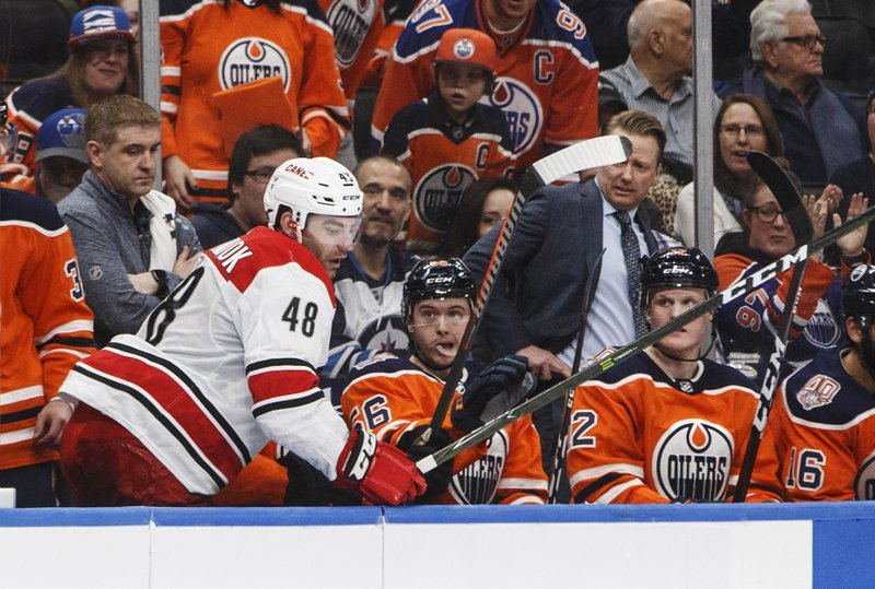 Carolina Hurricanes' Jordan Martinook (48) steps out of the the Edmonton Oilers bench after getting hit during the second period of an NHL hockey game in Edmonton, Alberta, Sunday, Jan. (Jason Franson/The Canadian Press via AP)