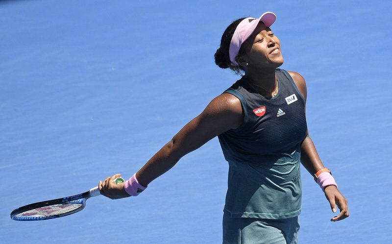 Japan's Naomi Osaka celebrates after defeating Latvia's Anastasija Sevastova during their fourth round match at the Australian Open tennis championships in Melbourne, Australia, Monday, Jan. (AP Photo/Andy Brownbill)