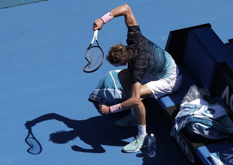 Germany's Alexander Zverev smashes his racket in frustration during his fourth round match against Canada's Milos Raonic at the Australian Open tennis championships in Melbourne, Australia, Monday, Jan. (AP Photo/Kin Cheung)
