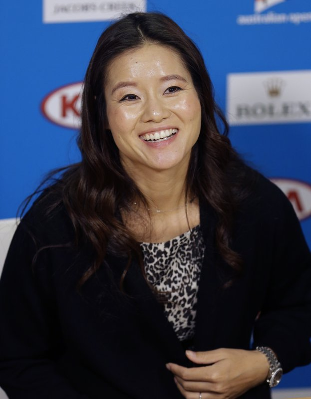 FILE- In this Jan. 20, 2015, file photo retired tennis championship Li Na of China, speaks at the Australian Open tennis championship in Melbourne, Australia. (AP Photo/Mark Baker, File)