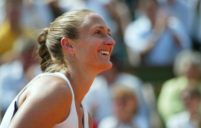 FILE- In this June 2, 2005, file photo France's Mary Pierce smiles as she plays Russia's Ellena Likhovtseva during their semifinal match of the French Open tennis tournament, at the Roland Garros stadium in Paris. (AP Photo/Lionel Cironneau, File)