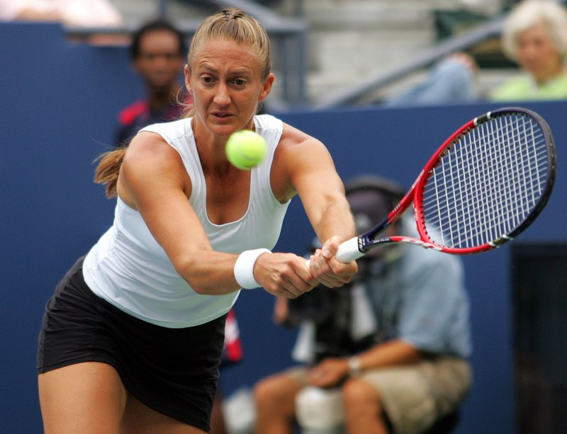 FILE- In this Aug. 30, 2006, file photo Mary Pierce of France returns a shot to Elena Vesnina of Russia at the US Open tennis tournament in New York. (AP Photo/Ed Betz, File)