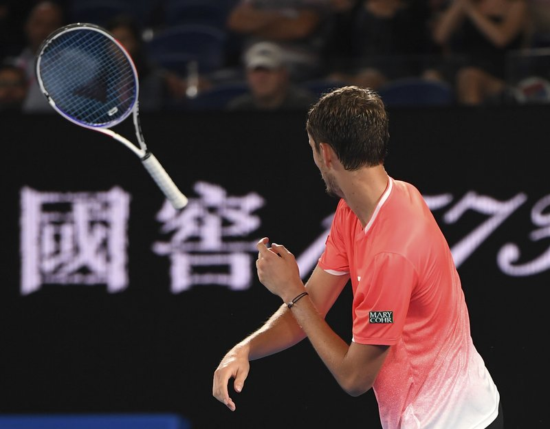 Russia's Daniil Medvedev throws his racket in frustration during his fourth round match against Serbia's Novak Djokovic at the Australian Open tennis championships in Melbourne, Australia, Tuesday, Jan. (AP Photo/Andy Brownbill)