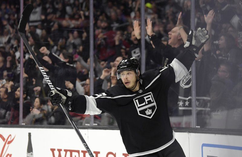 Los Angeles Kings right wing Dustin Brown celebrates a goal by center Anze Kopitar during the second period of an NHL hockey game against the St. (AP Photo/Mark J. Terrill)