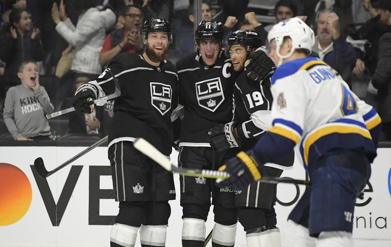 Los Angeles Kings center Anze Kopitar, second from left, celebrates his goal with defenseman Jake Muzzin, left, and left wing Alex Iafallo, second from right, as St. (AP Photo/Mark J. Terrill)