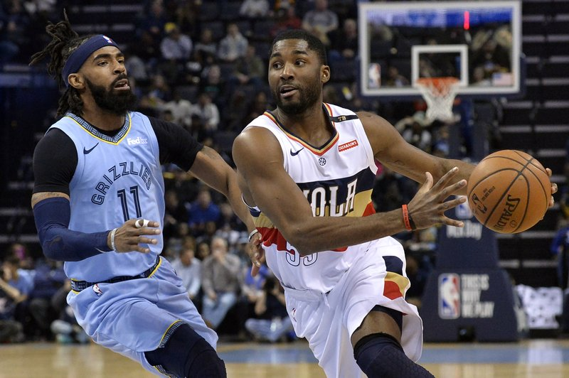 New Orleans Pelicans guard E'Twaun Moore (55) drives against Memphis Grizzlies guard Mike Conley (11) in the first half of an NBA basketball game Monday, Jan. (AP Photo/Brandon Dill)