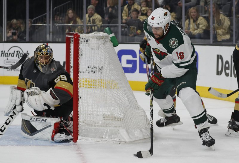 Minnesota Wild left wing Jordan Greenway (18) takes a shot against Vegas Golden Knights goaltender Marc-Andre Fleury (29) during the first period of an NHL hockey game Monday, Jan. (AP Photo/John Locher)