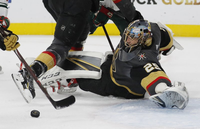 Vegas Golden Knights goaltender Marc-Andre Fleury (29) makes a save against the Minnesota Wild during the first period of an NHL hockey game Monday, Jan. (AP Photo/John Locher)