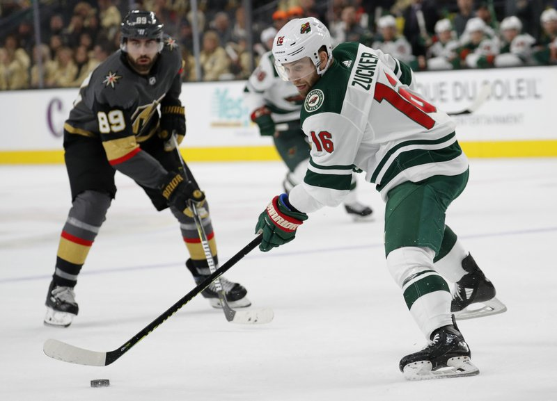 Minnesota Wild left wing Jason Zucker (16) passes the puck against the Vegas Golden Knights during the first period of an NHL hockey game Monday, Jan. (AP Photo/John Locher)