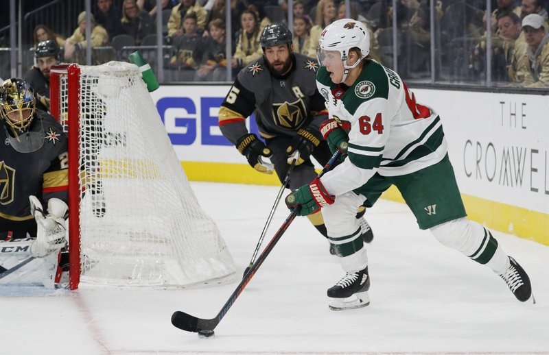 Minnesota Wild right wing Mikael Granlund (64) passes against the Vegas Golden Knights during the first period of an NHL hockey game Monday, Jan. (AP Photo/John Locher)
