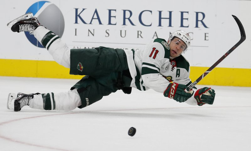 Minnesota Wild left wing Zach Parise (11) makes a diving pass for an assist against the Vegas Golden Knights during the third period of an NHL hockey game Monday, Jan. (AP Photo/John Locher)