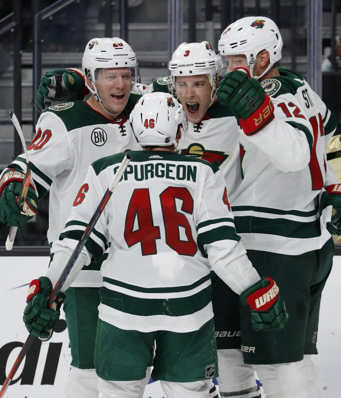 Minnesota Wild players celebrate after Charlie Coyle (3) scored against the Vegas Golden Knights during the third period of an NHL hockey game Monday, Jan. (AP Photo/John Locher)