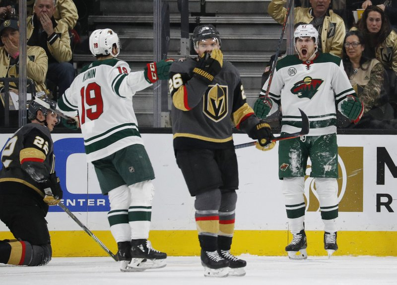 Minnesota Wild left wing Marcus Foligno, right, celebrates after scoring against the Vegas Golden Knights during the second period of an NHL hockey game Monday, Jan. (AP Photo/John Locher)