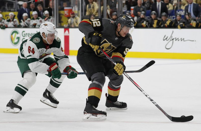 Vegas Golden Knights left wing Tomas Nosek (92) skates around Minnesota Wild right wing Mikael Granlund (64) during the second period of an NHL hockey game Monday, Jan. (AP Photo/John Locher)