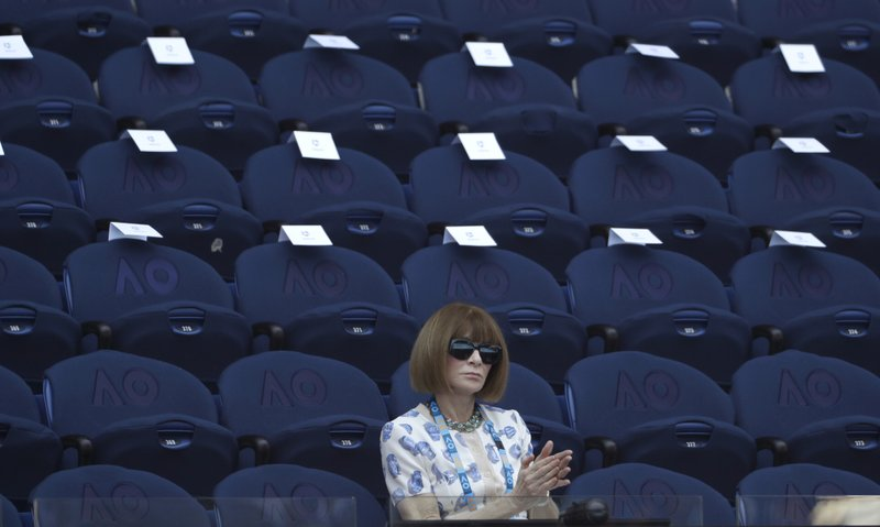 Anna Wintour watches the quarterfinal match between Spain's Roberto Bautista Agut and Greece's Stefanos Tsitsipas at the Australian Open tennis championships in Melbourne, Australia, Tuesday, Jan. (AP Photo/Mark Schiefelbein)