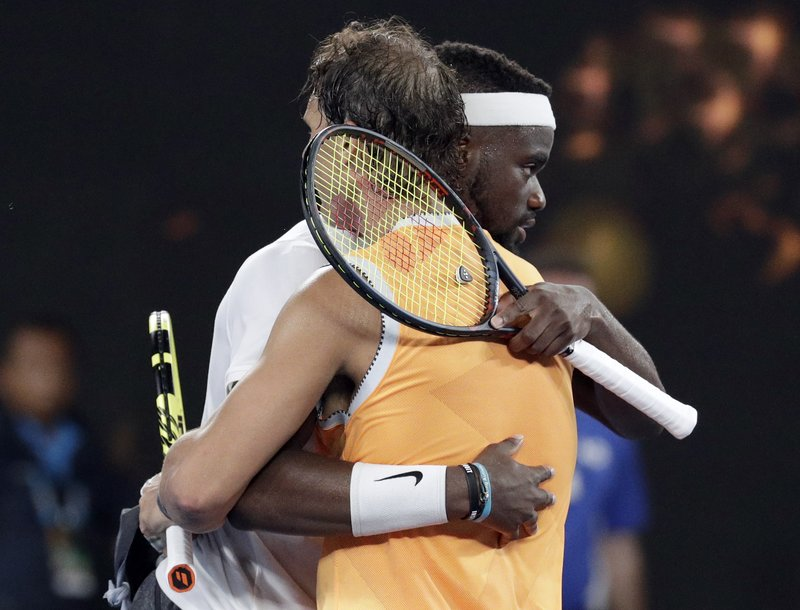 Spain's Rafael Nadal, front, is congratulated by United States' Frances Tiafoe after defeating him in their quarterfinal match at the Australian Open tennis championships in Melbourne, Australia, Tuesday, Jan. (AP Photo/Aaron Favila)