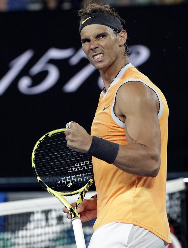 Spain's Rafael Nadal celebrates after defeating United States' Frances Tiafoe in their quarterfinal match at the Australian Open tennis championships in Melbourne, Australia, Tuesday, Jan. (AP Photo/Aaron Favila)