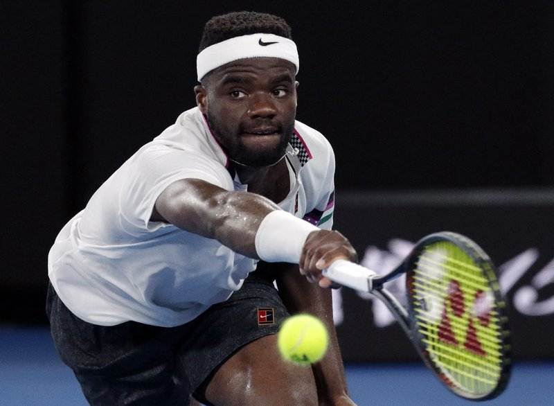 United States' Frances Tiafoe reaches for a return to Spain's Rafael Nadal during their quarterfinal match at the Australian Open tennis championships in Melbourne, Australia, Tuesday, Jan. (AP Photo/Aaron Favila)