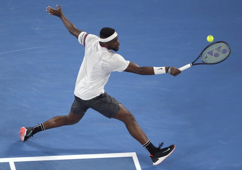 United States' Frances Tiafoe makes a backhand return to Spain's Rafael Nadal during their quarterfinal match at the Australian Open tennis championships in Melbourne, Australia, Tuesday, Jan. (AP Photo/Mark Schiefelbein)
