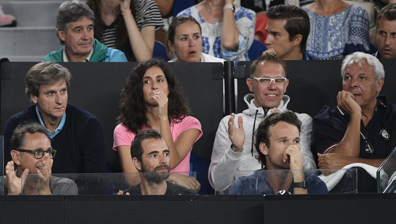 Supporters of Spain's Rafael Nadal sit in the players box during his quarterfinal against United States' Frances Tiafoe at the Australian Open tennis championships in Melbourne, Australia, Tuesday, Jan. (AP Photo/Andy Brownbill)