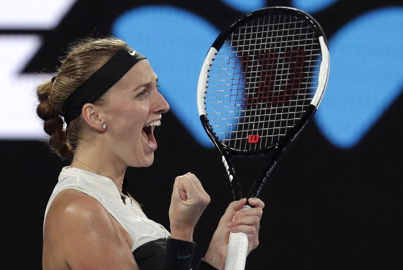Petra Kvitova of the Czech Republic celebrates after defeating Australia's Ashleigh Barty in their quarterfinal match at the Australian Open tennis championships in Melbourne, Australia, Tuesday, Jan. (AP Photo/Aaron Favila)