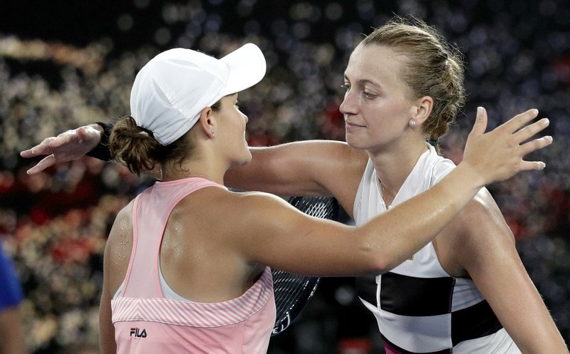 Petra Kvitova, right, of the Czech Republic is congratulated by Australia's Ashleigh Barty after winning their quarterfinal match at the Australian Open tennis championships in Melbourne, Australia, Tuesday, Jan. (AP Photo/Kin Cheung)