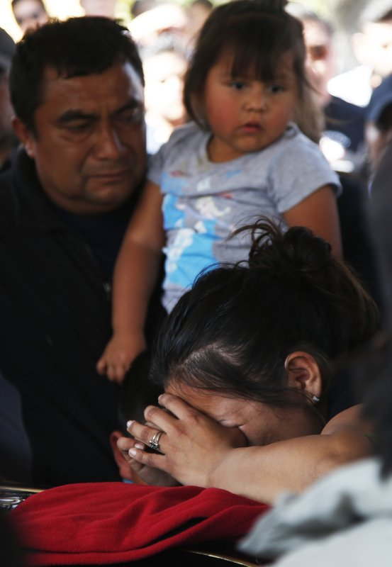 A woman cries during the funeral of a person who died when a gas pipeline exploded in the village of Tlahuelilpan, Mexico, Sunday, Jan. (AP Photo/Claudio Cruz)