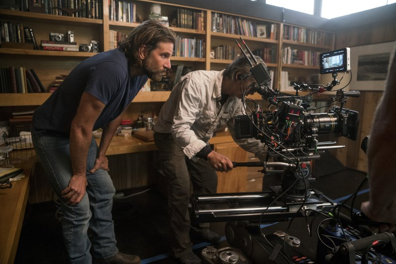 CORRECTS CATEGORY - This image released by Warner Bros. Pictures shows director/co-writer/producer Bradley Cooper, left, and camera operator Scott Sakamoto on the set of