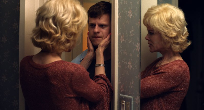 This image released by Focus Features shows Nicole Kidman, left, and Lucas Hedges in a scene from