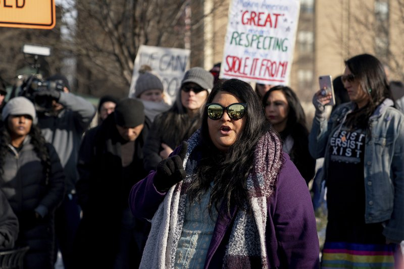 Carolina A. Castoreno-Santana, Executive Director of the American Indian Center of Indiana, speaks during a gathering in support of Native Americans in front of the Catholic Diocese in Covington, Ky. (AP Photo/Bryan Woolston)