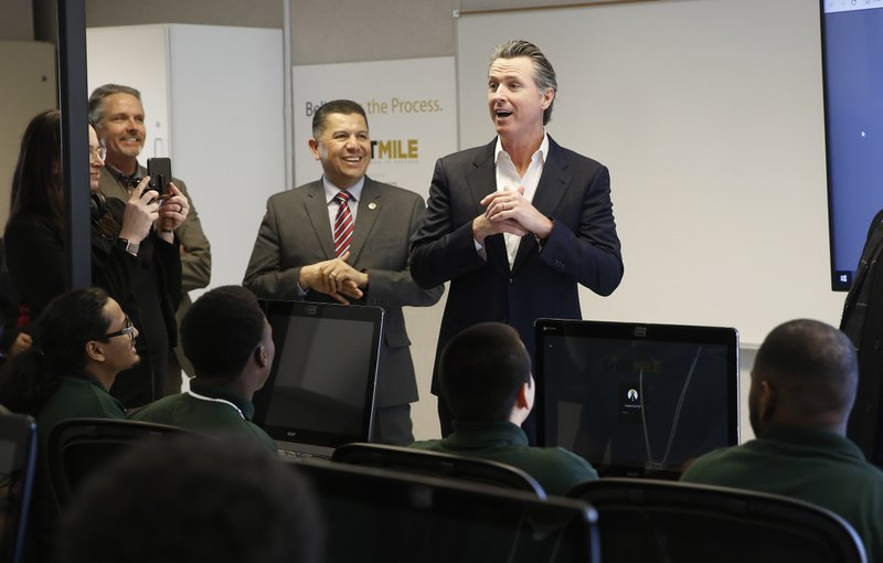 Gov. Gavin Newsom, right, addresses youthful offenders taking a computer coding class at the O.H. Close Youth Correctional Facility, Tuesday, Jan. (AP Photo/Rich Pedroncelli)