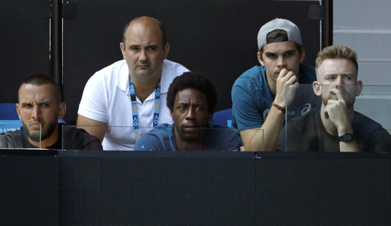 Gael Monfils sits in the players box of Ukraine's Elina Svitolina during her quarterfinal match against Japan's Naomi Osaka at the Australian Open tennis championships in Melbourne, Australia, Wednesday, Jan. (AP Photo/Mark Schiefelbein)