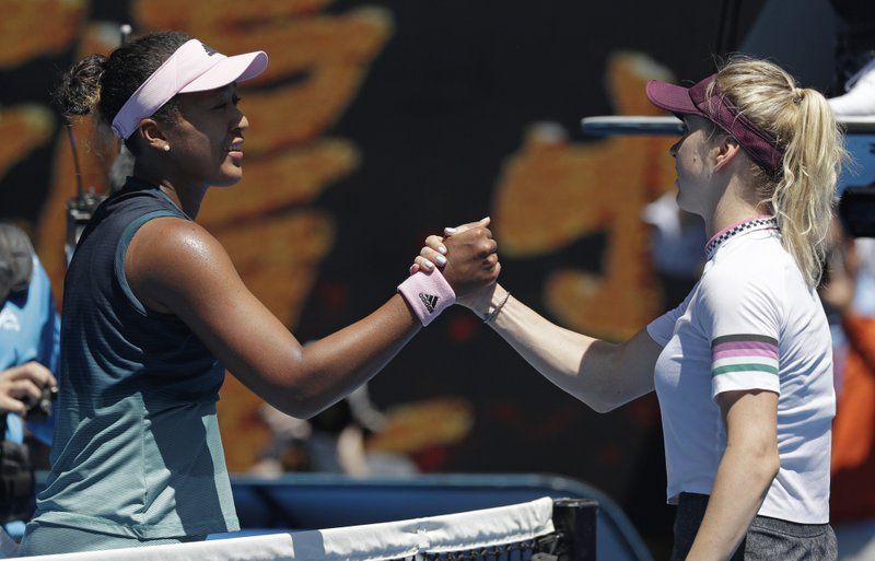 Japan's Naomi Osaka, left, is congratulated by Ukraine's Elina Svitolina after winning their quarterfinal match at the Australian Open tennis championships in Melbourne, Australia, Wednesday, Jan. (AP Photo/Kin Cheung)