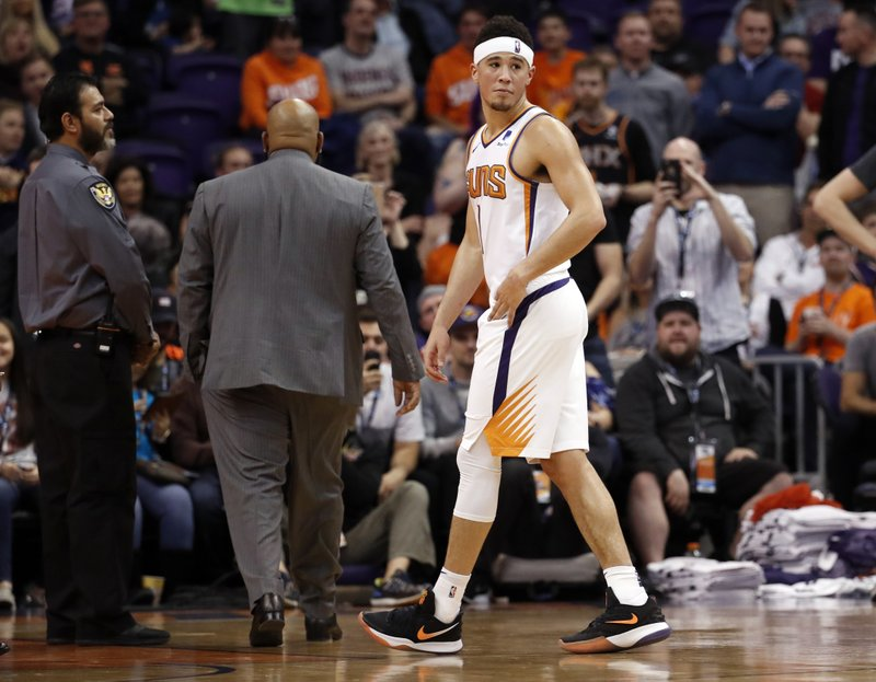 Phoenix Suns guard Devin Booker (1) leaves the game after being ejected during the second half of an NBA basketball game against the Minnesota Timberwolves, Tuesday, Jan. (AP Photo/Matt York)