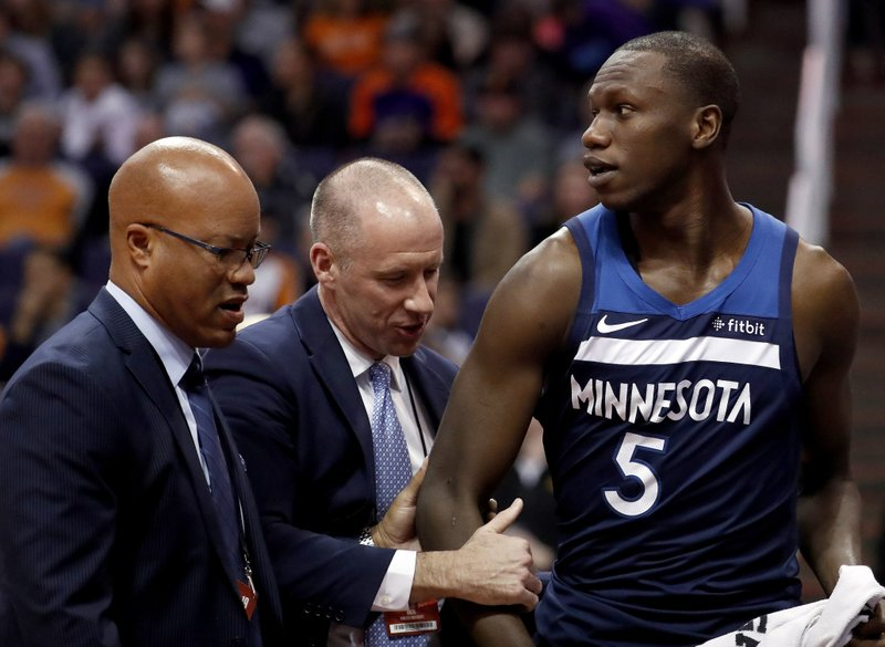 Minnesota Timberwolves center Gorgui Dieng (5) leaves the game after being ejected during the second half of an NBA basketball game against the Phoenix Suns, Tuesday, Jan. (AP Photo/Matt York)