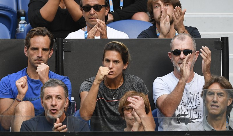 Amelie Mauresmo, center, coach of France's Lucas Pouille, watches from the players box during his quarterfinal match against Canada's Milos Raonic at the Australian Open tennis championships in Melbourne, Australia, Wednesday, Jan. (AP Photo/Andy Brownbill)