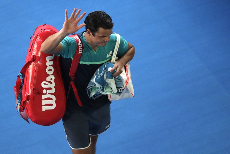 Canada's Milos Raonic waves as he leaves Rod Laver Arena following his quarterfinal loss to France's Lucas Pouille at the Australian Open tennis championships in Melbourne, Australia, Wednesday, Jan. (AP Photo/Kin Cheung)