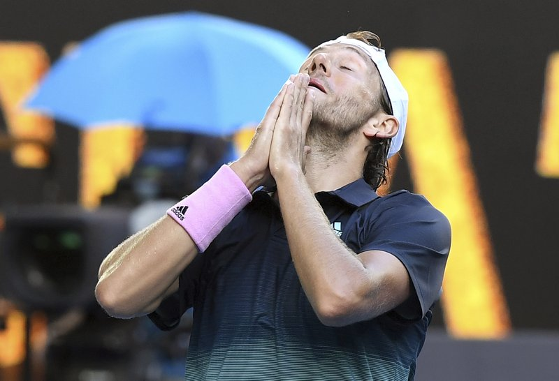 France's Lucas Pouille celebrates after defeating Canada's Milos Raonic in their quarterfinal match at the Australian Open tennis championships in Melbourne, Australia, Wednesday, Jan. (AP Photo/Andy Brownbill)