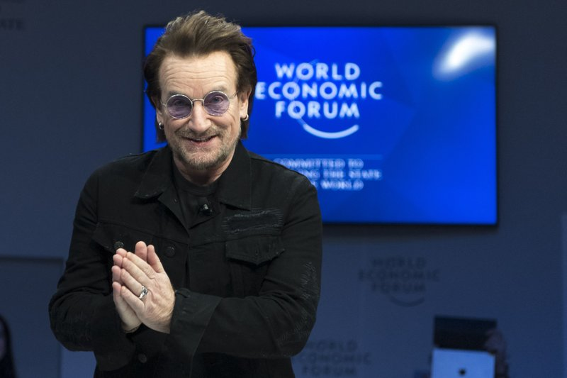 Irish singer Bono gestures as he arrives for a panel session during the the 49th Annual Meeting of the World Economic Forum, WEF, in Davos, Switzerland, Wednesday, Jan. (Laurent Gillieron/Keystone via AP)