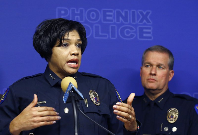 Phoenix Police Chief Jeri Williams, left, announces the arrest of Nathan Sutherland, a licensed practical nurse, on one count of sexual assault and one count of vulnerable adult abuse on an incapacitated woman who gave birth last month at a long-term health care facility Wednesday, Jan. (AP Photo/Ross D. Franklin)