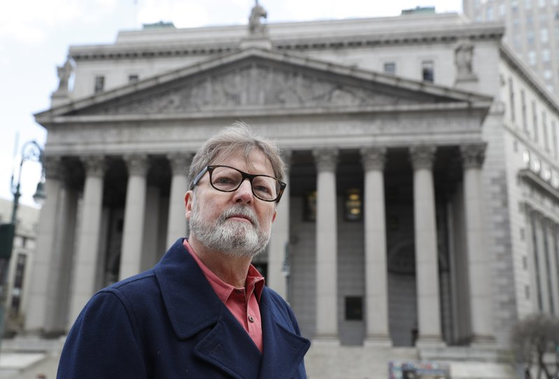 Brian Toale, 65, a sexual abuse victim when he was a student in a Long Island Catholic school, and now an activist, poses for a photograph in front of Thurgood Marshall Courthouse in New York's Foley Square on Wednesday, Jan. (AP Photo/Kathy Willens)