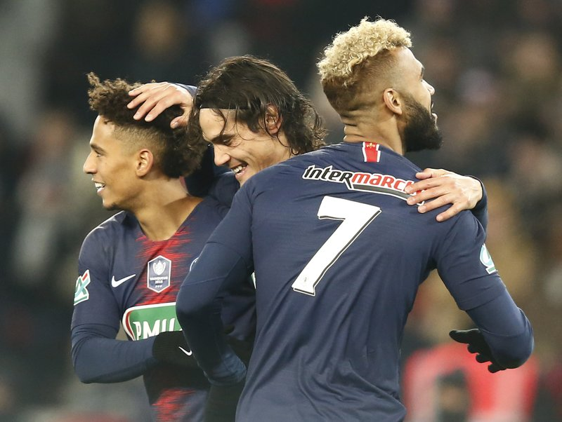 PSG's Edinson Cavani, center reacts after scoring the opening goal with his teammates PSG's Thilo Kehrer, lefty, and PSG's Eric Maxim Choupo-Moting, right, during the French Cup soccer match between Paris Saint Germain and Strasbourg at the Parc des Princes stadium in Paris, Wednesday, Jan. (AP Photo/Michel Euler)