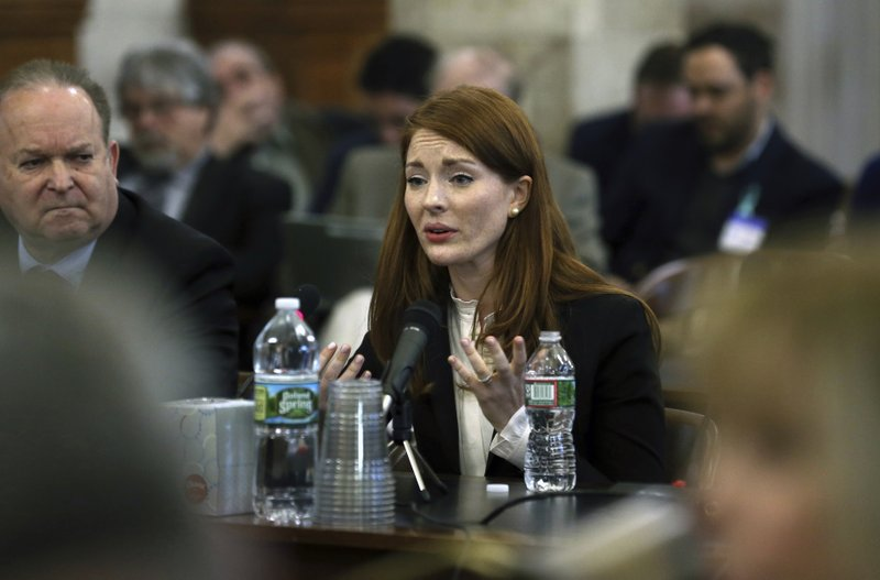 FILE- In this Dec. 4, 2019 file photo, Katie Brennan, the chief of staff at the New Jersey Housing and Mortgage Finance Agency, answers a question as she testifies before the Select Oversight Committee at the Statehouse in Trenton, N. (AP Photo/Mel Evans, File)