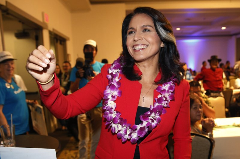 FILE - In this Nov. 6, 2018, file photo, Rep. Tulsi Gabbard, D-Hawaii, greets supporters in Honolulu. (AP Photo/Marco Garcia, File)