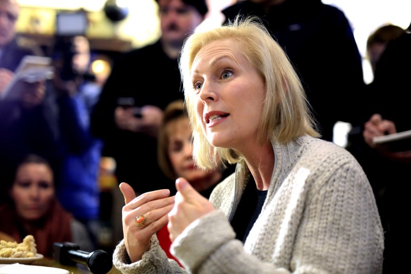In this Jan. 18, 2019, photo, Sen. Kirsten Gillibrand, D-N.Y., meets with residents at the Pierce Street Coffee Works cafe, in Sioux City, Iowa. (AP Photo/Nati Harnik)