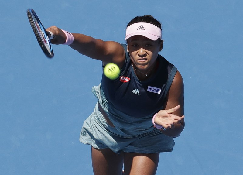 Japan's Naomi Osaka makes a forehand return to Ukraine's Elina Svitolina during their quarterfinal match at the Australian Open tennis championships in Melbourne, Australia, Wednesday, Jan. (AP Photo/Aaron Favila)