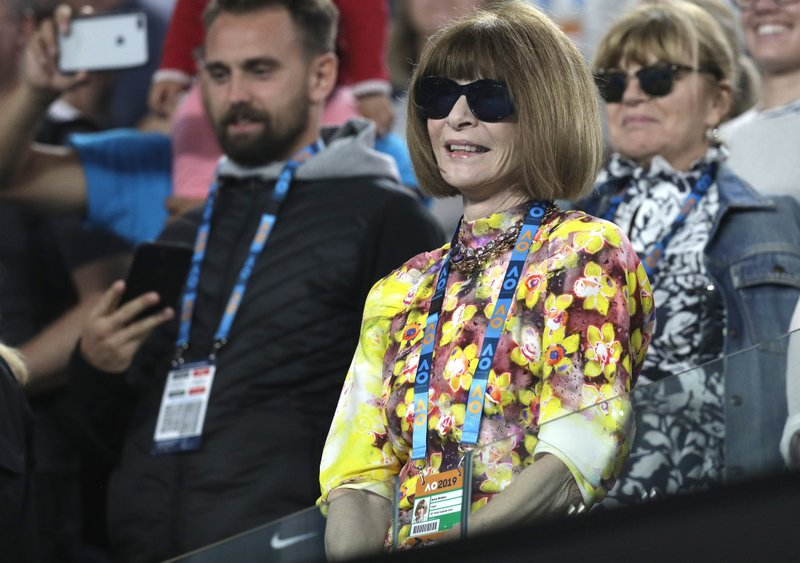 Fashion editor Anna Wintour watches the fourth round match between Romania's Simona Halep and United States' Serena Williams at the Australian Open tennis championships in Melbourne, Australia, Monday, Jan. (AP Photo/Kin Cheung)