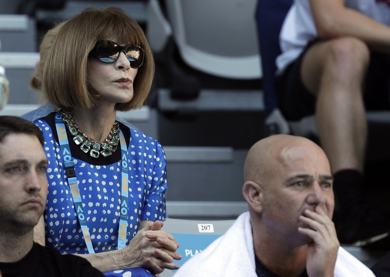 Fashion editor Anna Wintour watches the fourth round match between United States' Frances Tiafoe and Bulgaria's Grigor Dimitrov at the Australian Open tennis championships in Melbourne, Australia, Sunday, Jan. (AP Photo/Kin Cheung)